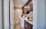 Laundry room with stone flooring, full wood cabinets, granite counter with undermount sink!