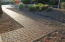 Gorgeous paver walkway leading up to courtyard and front entrance