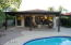Detached guest casita with private covered porch, sliding glass door, two ceiling fans