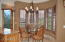 BREAKFAST ROOM IN KITCHEN W/ VIEWS OF GOLF COURSE