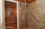 Large walk-in shower in guest casita is in between two bathrooms