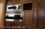 close up of stainless steel Wolf wall oven and built in microwave.