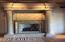 close up of stone work surrounding living room fireplace