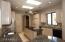 Skylights create light bright environment in kitchen.