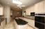 Granite countertops & electric cooktop w/double wall ovens