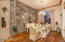 The perfect ambiance with the stone wall and wood flooring.