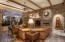 Gorgeous stone accent wall, wood beams on the ceiling. Beautiful!