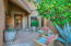 Intimate courtyard leads to stylish iron/wood entry door. Gainey Ranch Homes feel private