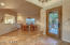 Formal dining with cafe bar all open to the kitchen pass through. Gainey Ranch