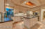 Entertainers spacious kitchen with working island, wine fridge, gas cook top, RO drinking, spacious open windows, solid wood cabinetry and custom stone backsplash