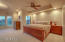 Main Master bedroom with sitting area with VIEWS to mountain and golf course and SUNSETS that are amazing!