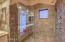 Beautiful slate shower with custom etched glass, multiple shower heads and clear glass enclosure