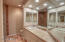 3rd bath downstairs with added recessed lighting, stone counters and kohler fixtures and solid wood cabinets.