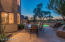 Flagstone flooring with abundance of sitting area and landscape lighting, view fence to experience the joy of serenity in the summers at Gainey Ranch in Scottsdale Arizona
