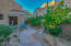 Walk up to your home through this courtyard entry and enjoy the citrus trees!
