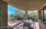 Dining area of covered patio. Gas fireplace on left faces the patio.