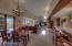 Great Room with dining and living areas, breakfast bar to right. Gas fireplace in living area.