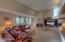 Living area of Great Room. Large windows provide plenty of natural light. Cozy gas fireplace and area for large, flat scree TV.