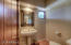 Powder room with pedestal sink. Located off of the front hall.