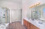 Lovely master bath with double sinks, separate tub/shower and large walk in closet