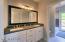 Slab Quartz Counters in Hall Bath