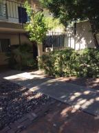 Front courtyard - condo in corner