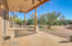 Pine wood pillars and flagstone pavers for the Southwest feel