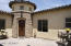 The charming courtyard is enclosed and gated for extra safety, privacy, and additional space to entertain or lounge. The central entry has 15' ceiling and stone flooring and a JELD-WEN old world front door.