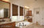 The bathrooms features Kohler fixtures, upgraded custom quartz counters and custom Hunter-Douglas wood shades.