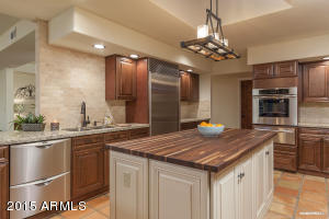 Brand new gourmet kitchen with granite counter tops, walnut wood center island & stainless steel appliances.