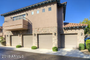 Two side by side garage doors for this condo. Spacious garage even has room for refrigerator.