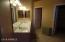 2 sinks, separate toilet room (door on left). Closet door is on the right.
