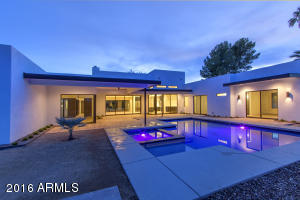 Contemporary salt water pool and hot tub. Situated just steps off of the 800 sf of covered patio space.