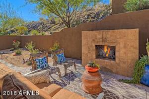Stunning backyard with a gas fireplace.