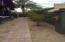 This brick-paver walkway is the property line to 547 W Portland