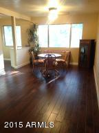 View of living/dining with frash paint & new laminate wood flooring from entry