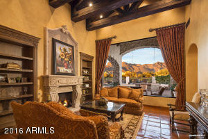 Formal Living Room with seamless glass views of Superstition Mountain
