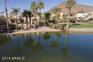 Villa patio overlooks a large Pond and is across from Camelback Mountain.