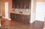 Such a warm feeling: wood tile floors, custom paint, granite, back splash, 4in base boards.