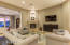 Stone fireplace surround, 12 foot ceilings and recessed lighting!