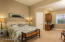 En-suite with full bath, walk-in closet and built-in desk/office area.