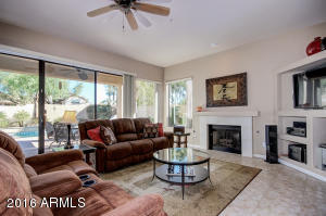 Welcome home!! Fabulous family room looking out to the gorgeous pool and patio area