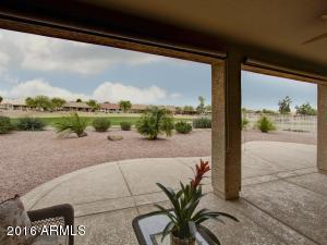 Covered patio overlooks the golf course.