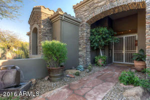 flagstone paved entry with water feature
