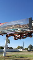 Billboard in middle lot pays $ 5000/yr.--more than taxes.