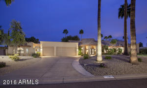 Gorgeous curb appeal...note the Guest House with private gated courtyard entry