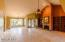 Light and bright interiors with high vaulted ceilings. No step downs! Elegant travertine floors.