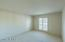 Spacious, good size room. Light colored Shutters add to the rooms lightness.