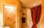 Beautiful , warm , elegant guest bathroom.