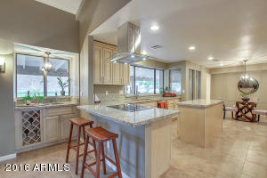Kitchen /Family room/ Bar outdoors all blend for the perfect home!